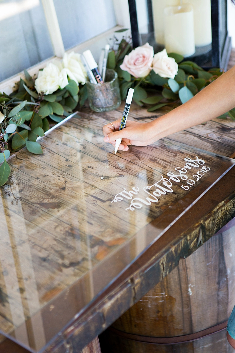 Modern clear acrylic wedding guest book for guests to sign with white permanent marker