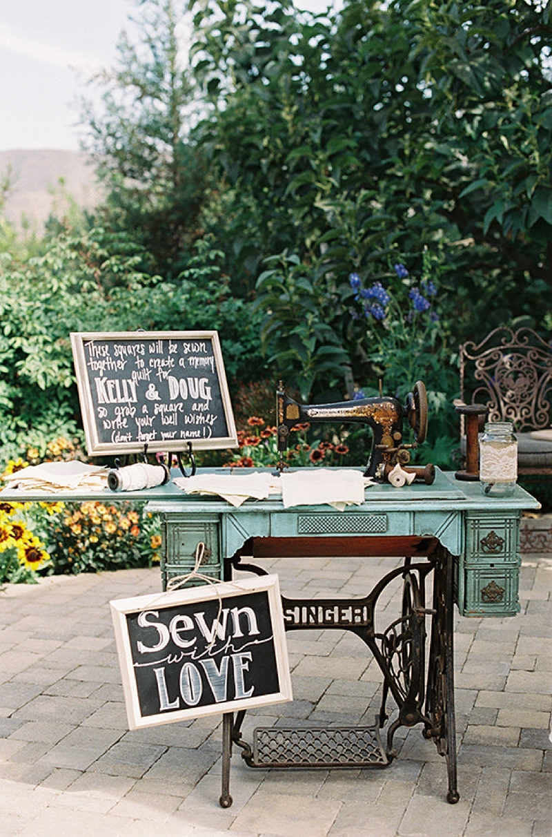 Unique wedding quilt sewing station for guests to sign their name on a fabric square