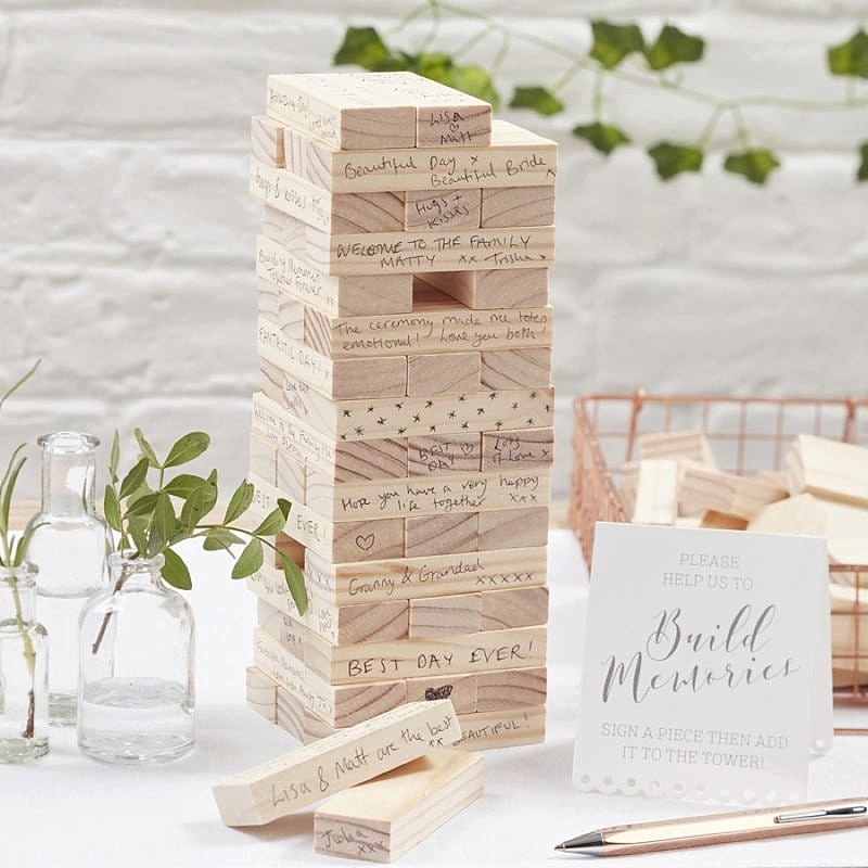 Wooden Jenga puzzle tower wedding guest book for unique way for guests to sign and play afterwards