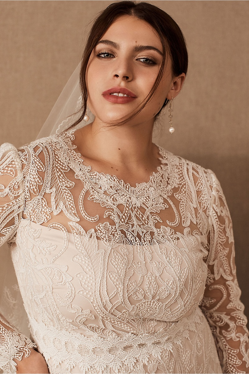 Chic short lace wedding dress with bell sleeves perfect for a sophisticated courthouse wedding