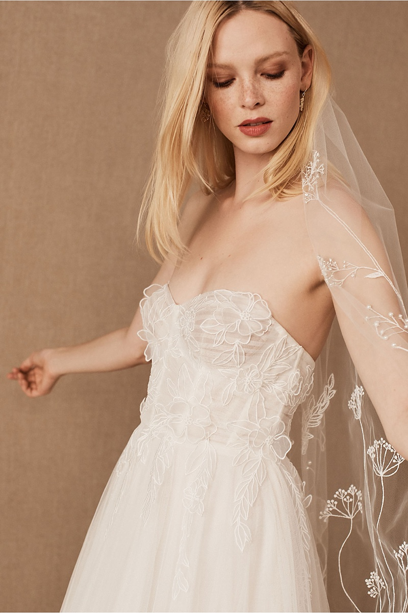 Strapless wedding dress with sweetheart neckline and structured bodice for romantic bridal style
