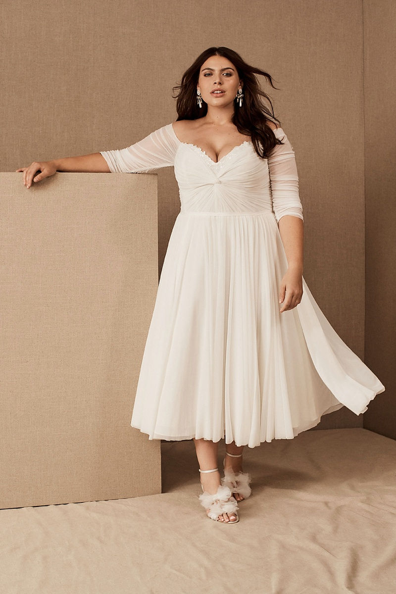 Tea length wedding dress with stretch mesh and low neckline with sequins