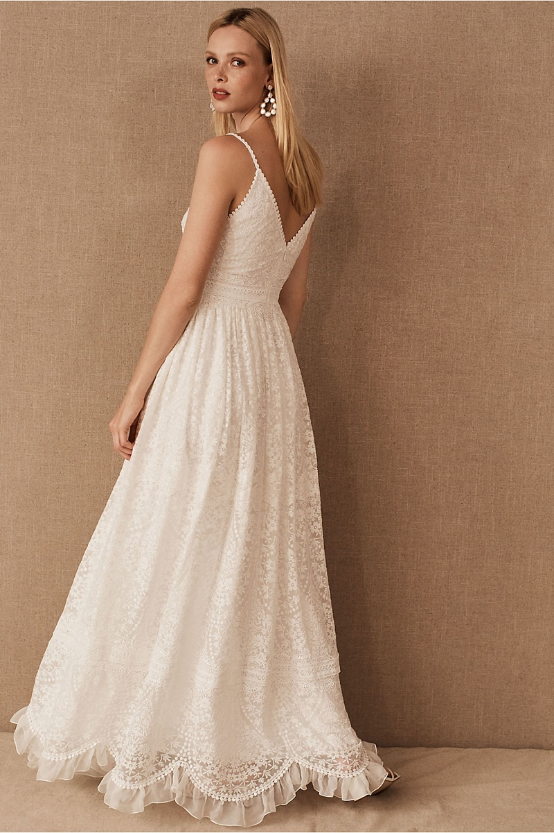 Boho inspired wedding gown with surprise delicate ruffle hem and spaghetti straps