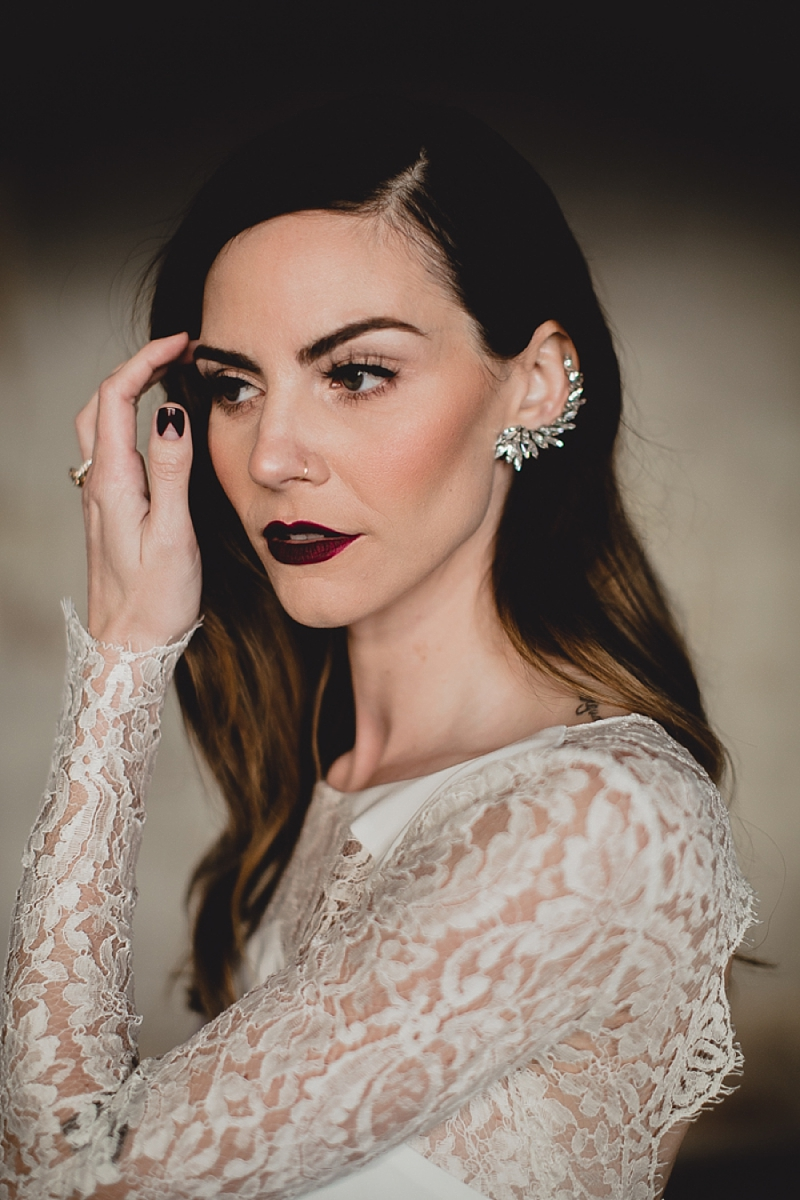 Edgy alt bride with silver wedding ear cuff with pointed crystals