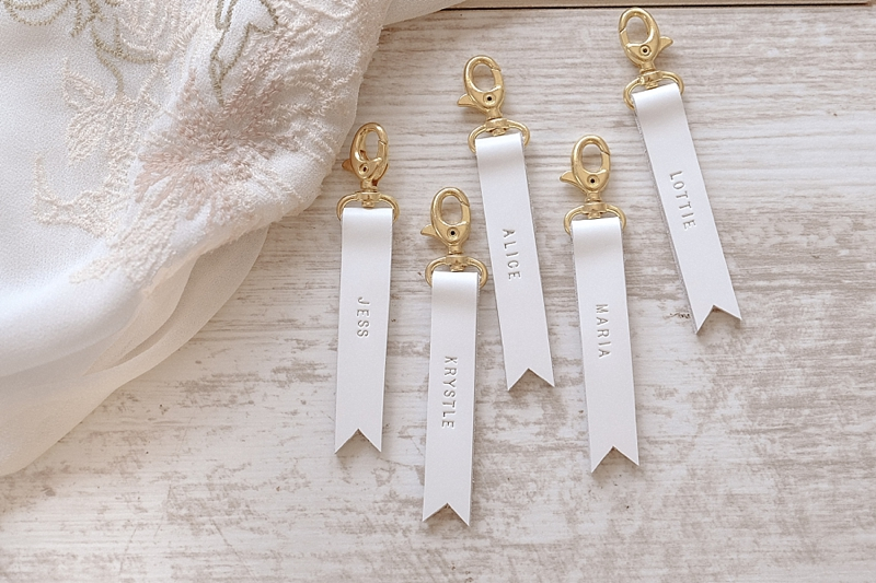 Personalized white leather keychains for unique and practical bridesmaid wedding gift