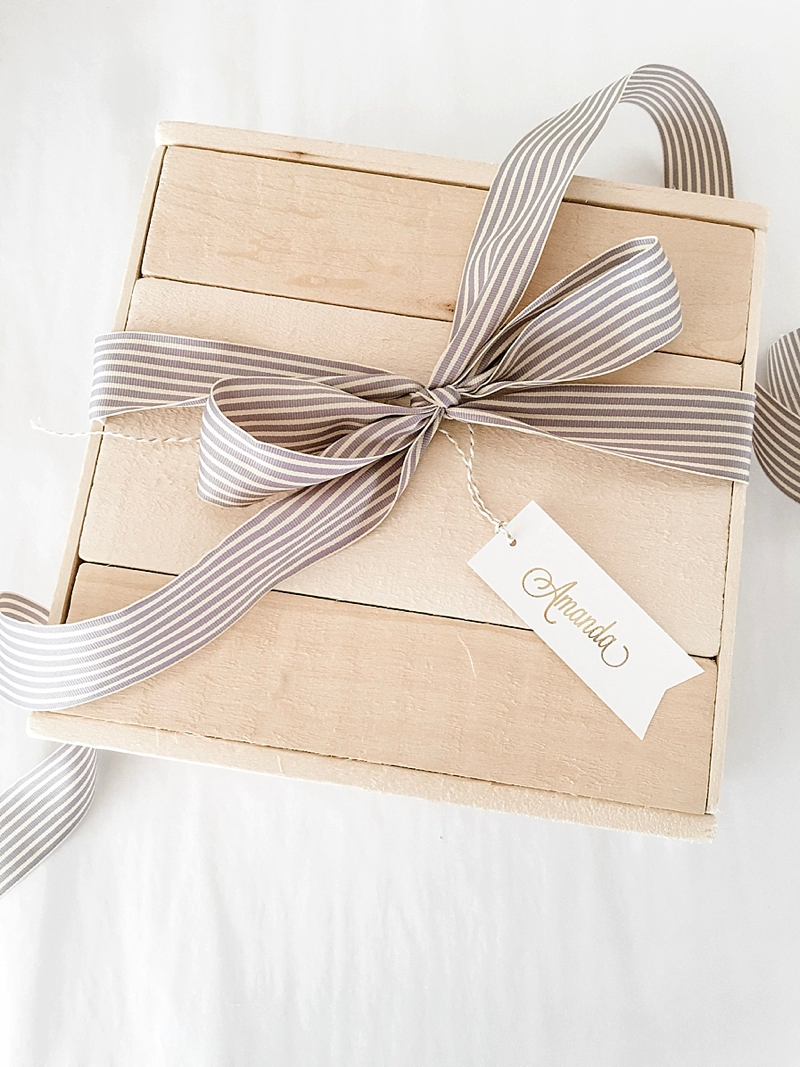 Chic wooden gift box with ribbon and personalized tag for unique bridesmaid wedding packaging