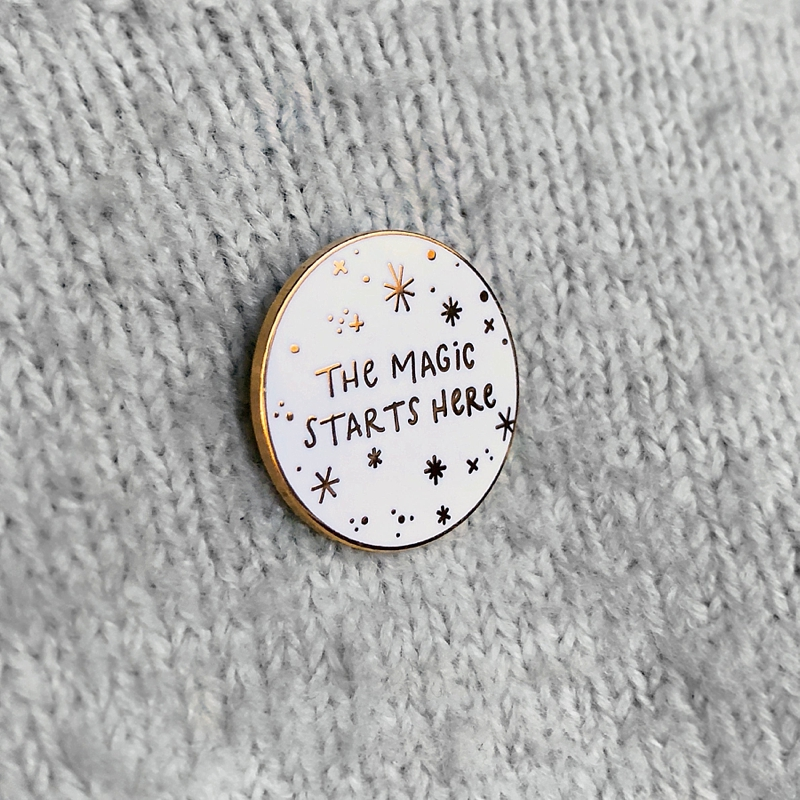 Modern The Magic Starts Here enamel pin for a holiday inspired stocking stuffer