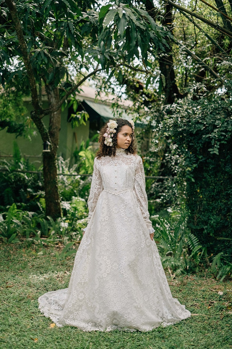 Vintage cottagecore wedding dress with high neck collar and long puffed sleeves