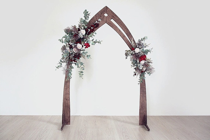 Unique cottagecore wood wedding arch for beautiful ceremony decor