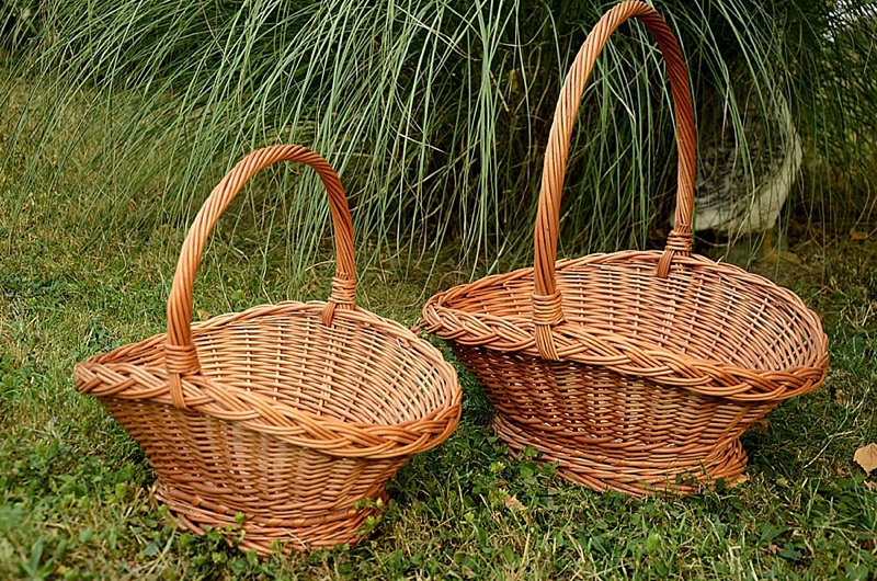 Wicker flower girl baskets for cottagecore wedding day in the country