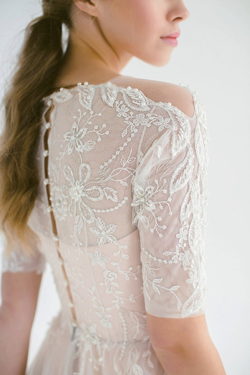 Modern vintage wedding dress with embroidered beads for a cottagecore bride