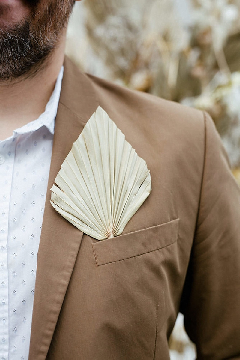 Simple dried sun palm leaf for a minimalist boho wedding boutonniere