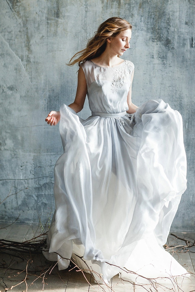 Romantic blue gray wedding dress with flowy skirt and sleeveless bodice perfect for a beach bride