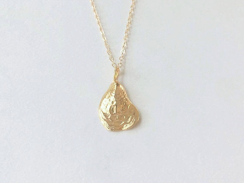 Gold petite oyster shell necklace perfect for a beach bridesmaid wedding gift idea
