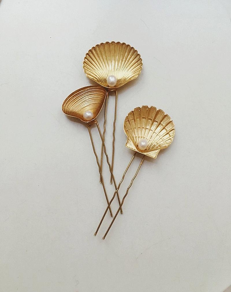 Gold seashell bridal hair pins with pearl detail for a beach wedding
