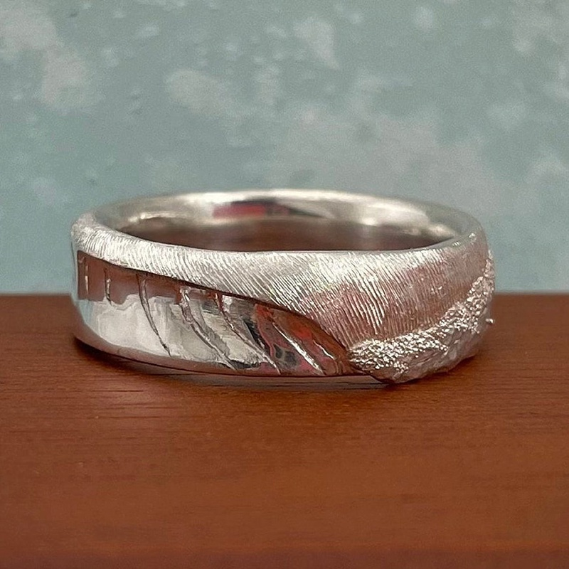 Ocean wave inspired beach wedding ring inspired by the coast