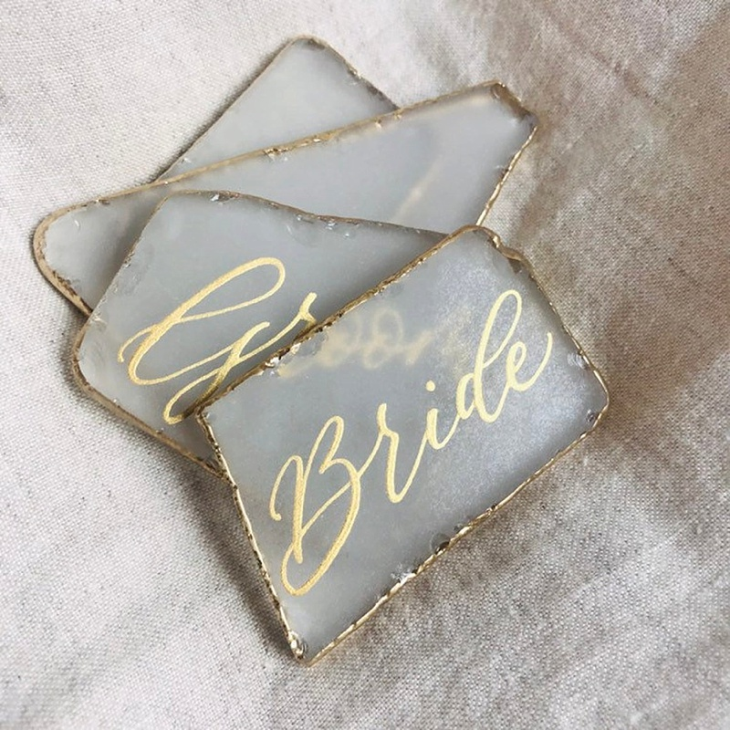Elegant unique seaglass wedding place cards with gold edges and lettering perfect for a beach wedding