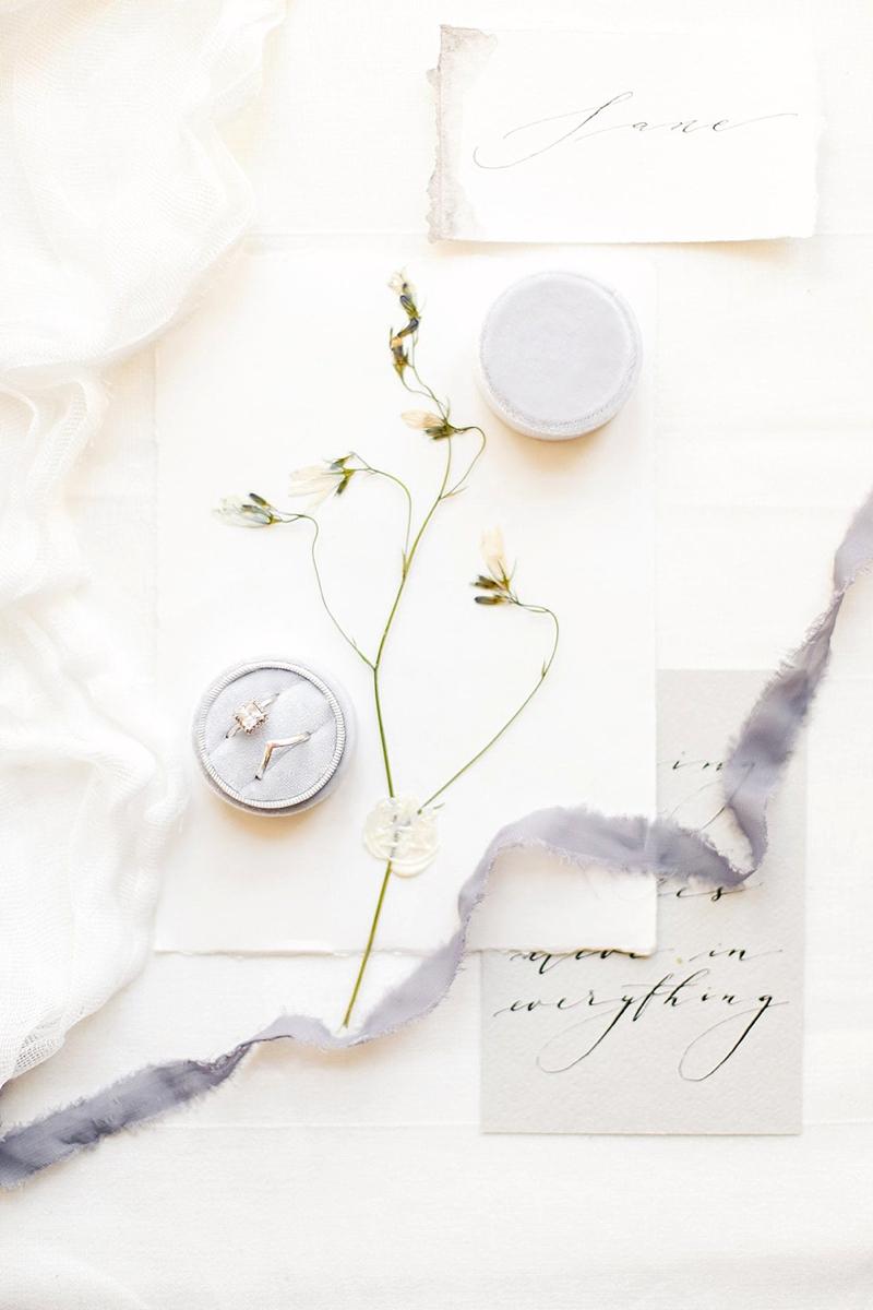 Light gray velvet engagement ring box designed for two wedding rings