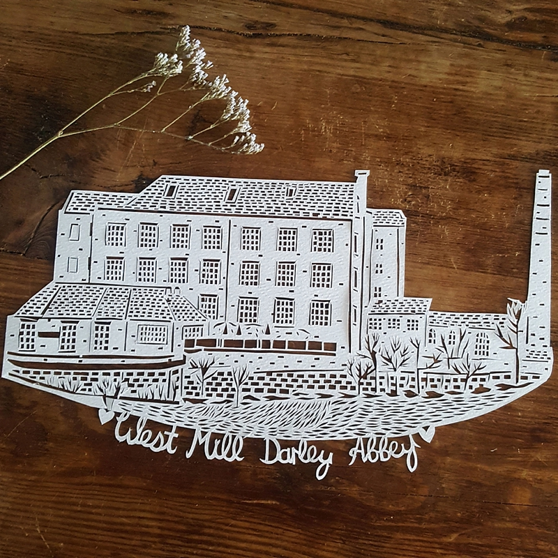 Handmade papercut of wedding venue for unique first anniversary gift idea