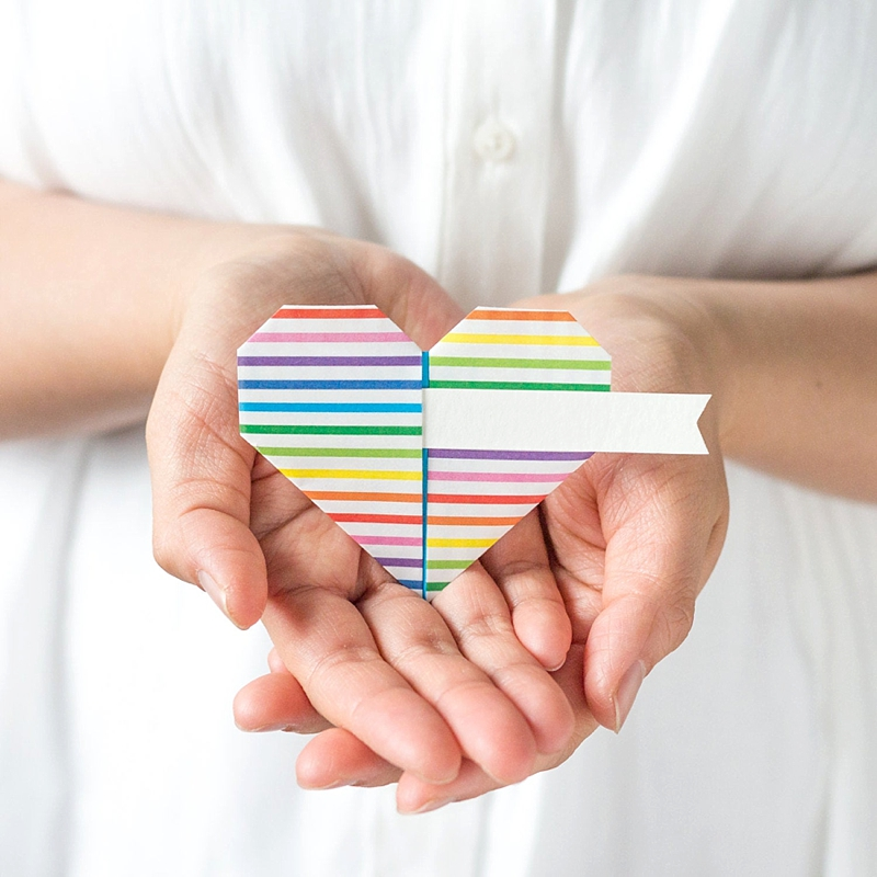 Paper rainbow origami heart for gay pride wedding escort card