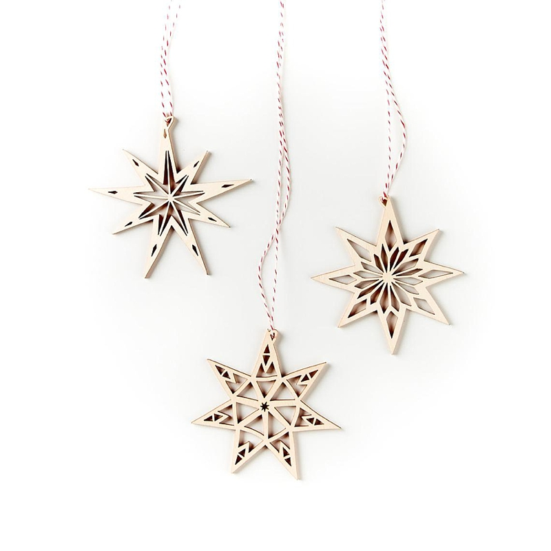 Modern laser cut birch wood star ornaments for gift of hope at Christmas