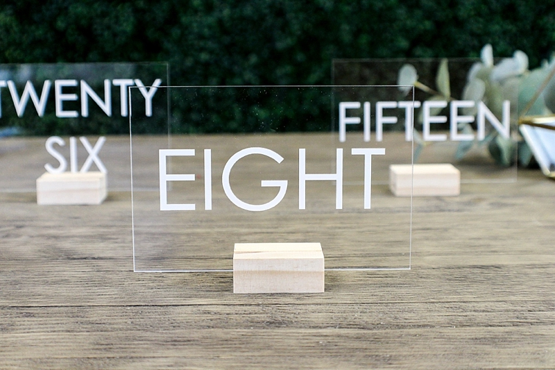 Clear see through acrylic wedding table numbers with white lettering for modern minimalist wedding