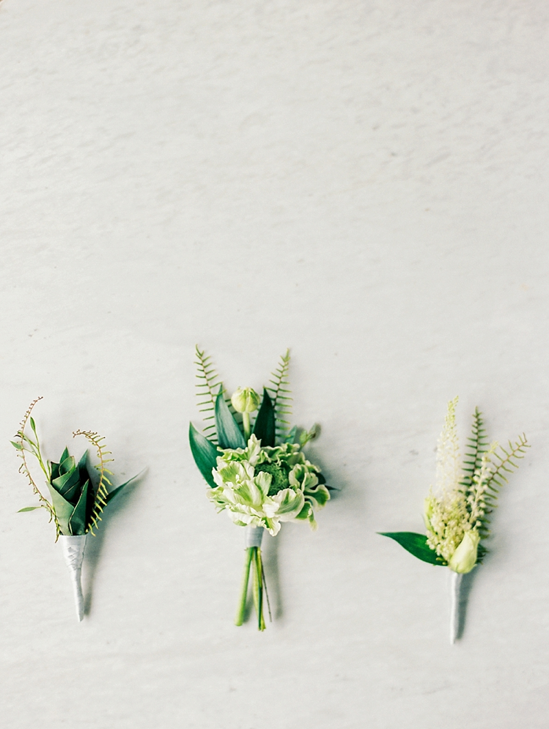 Ideas for minimalist wedding boutonnieres using minimal florals and greenery