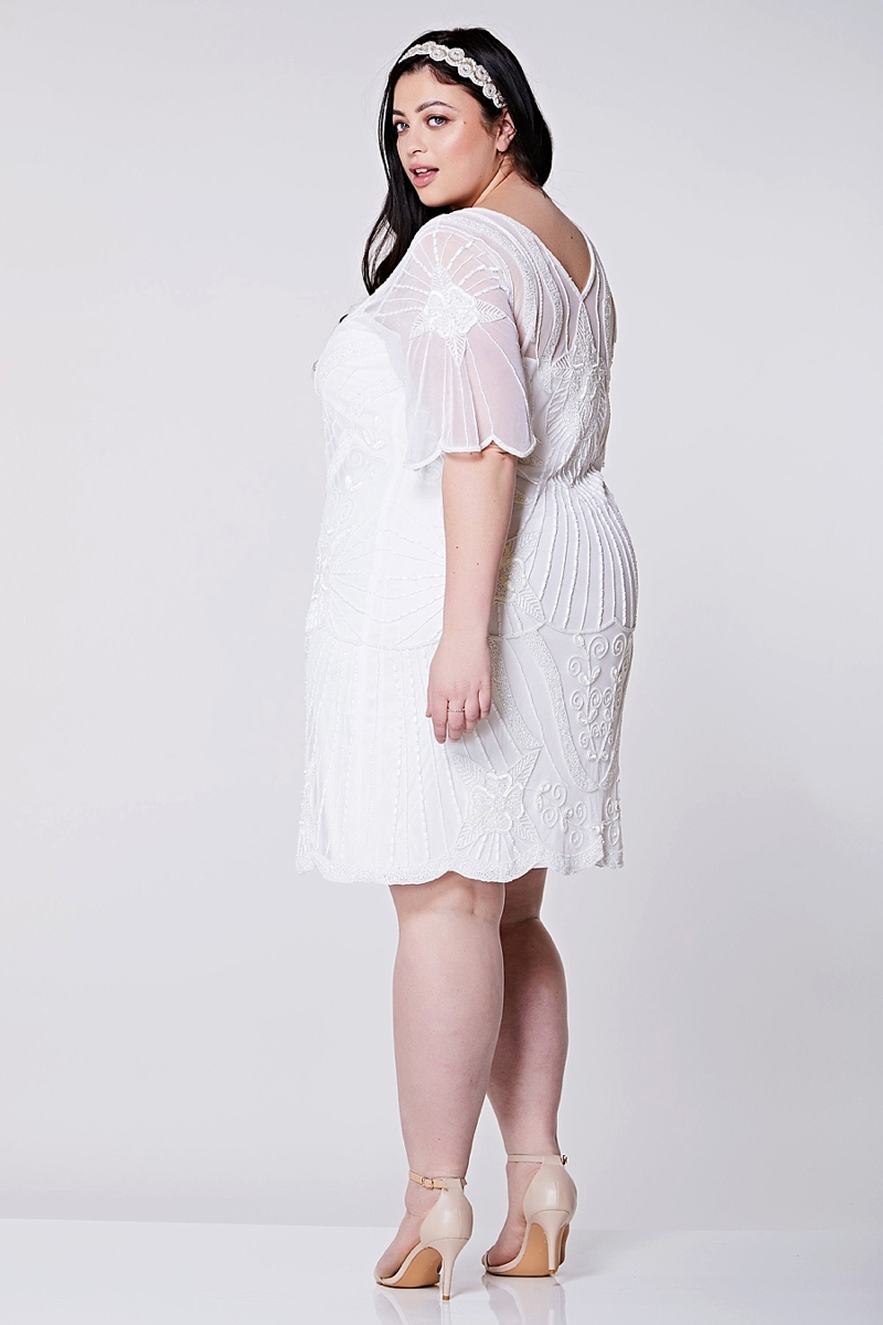 Knee length white beaded Gatsby inspired plus size wedding reception dress with art deco design