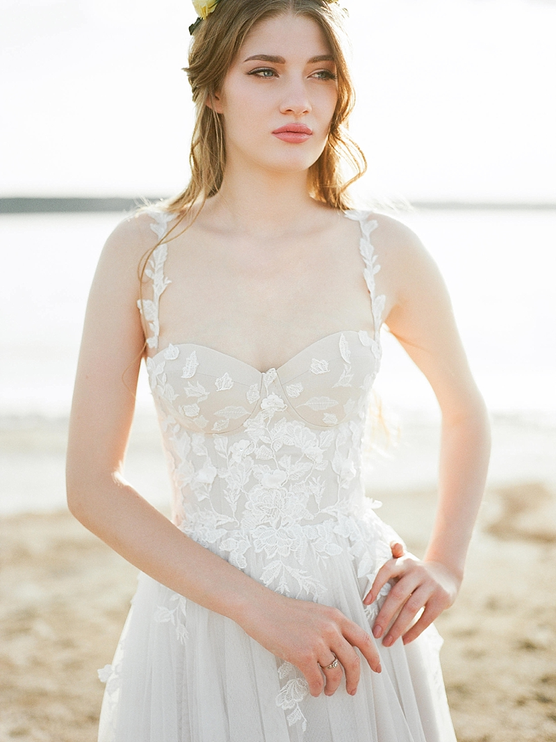 Neutral colored wedding gown with lace appliques and sculpted bodice perfect for summer weddings