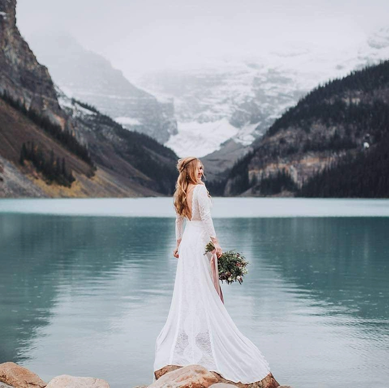 Long low back lace wedding dress perfect for destination weddings