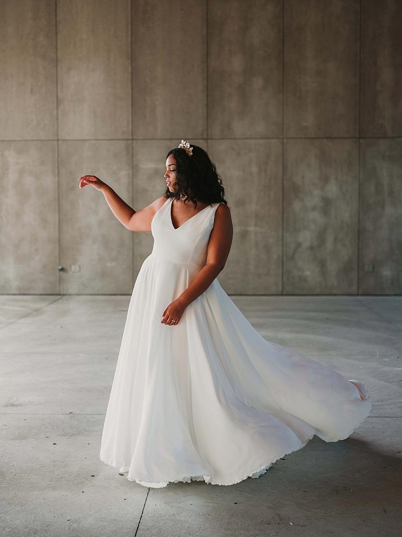 Modern minimalist plus size wedding dress with full skirt made of Italian crepe