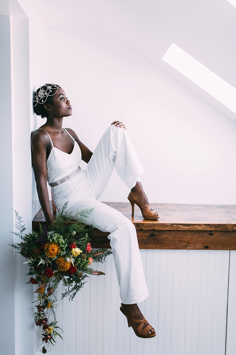 Modern wedding jumpsuit or pantsuit with spaghetti straps and belted sash and wide legs