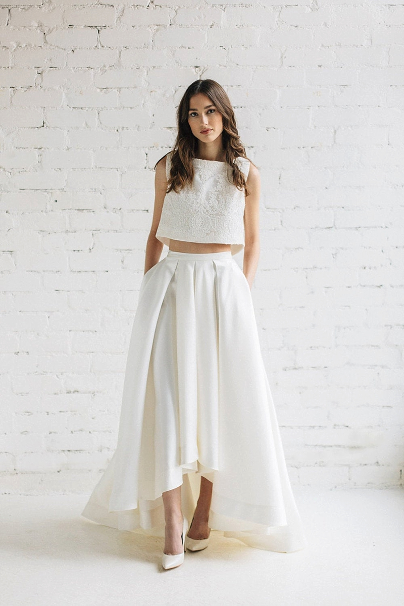 Modern trendy white satin crop top wedding gown with high low pleated skirt