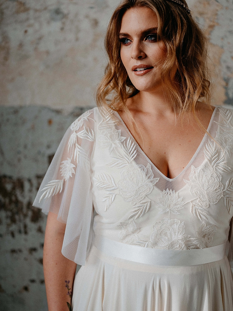 Sheer embroidered bridal top with flutter sleeves for plus size bride