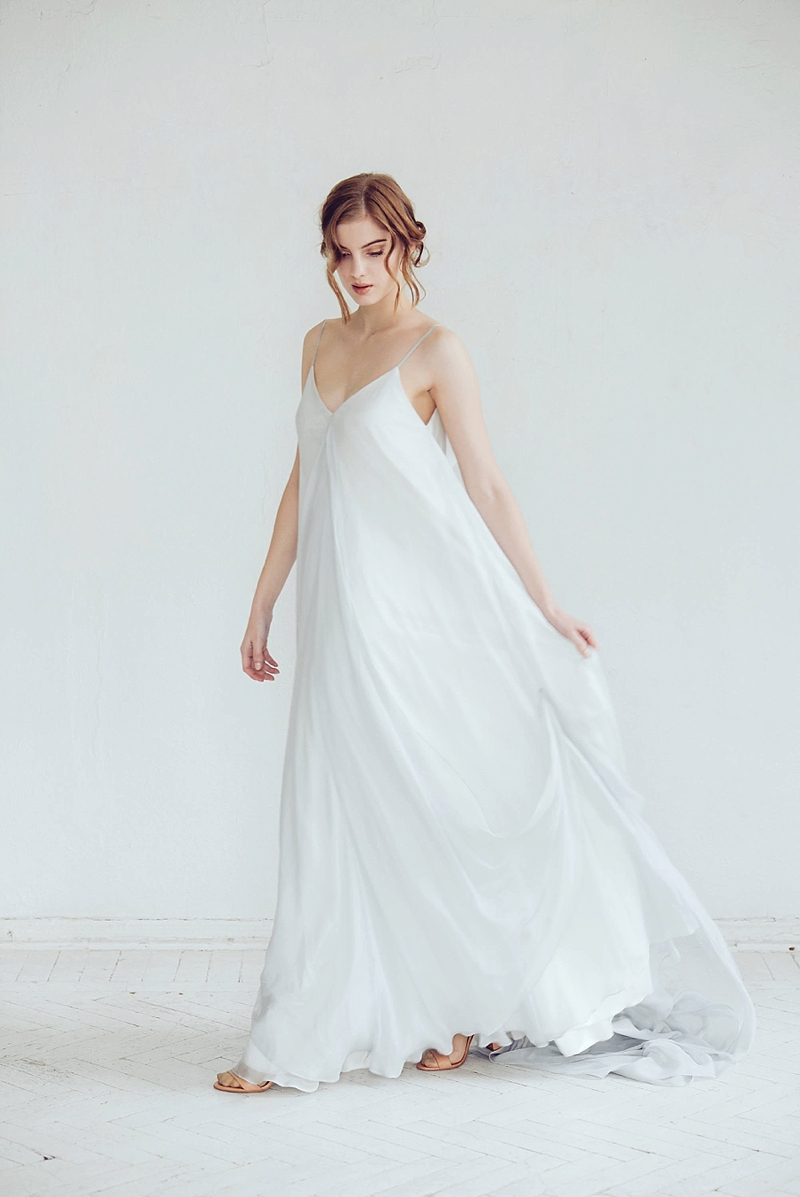 White flowy free fitting maternity wedding gown with open back and spaghetti straps for pregnant bride