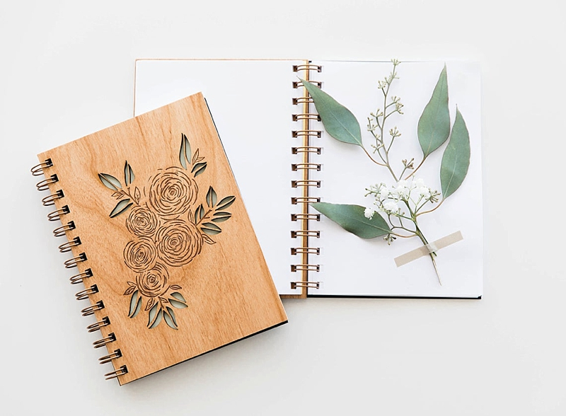 Flower engraved wooden cover for a wedding planning notebook for mother of the bride or groom