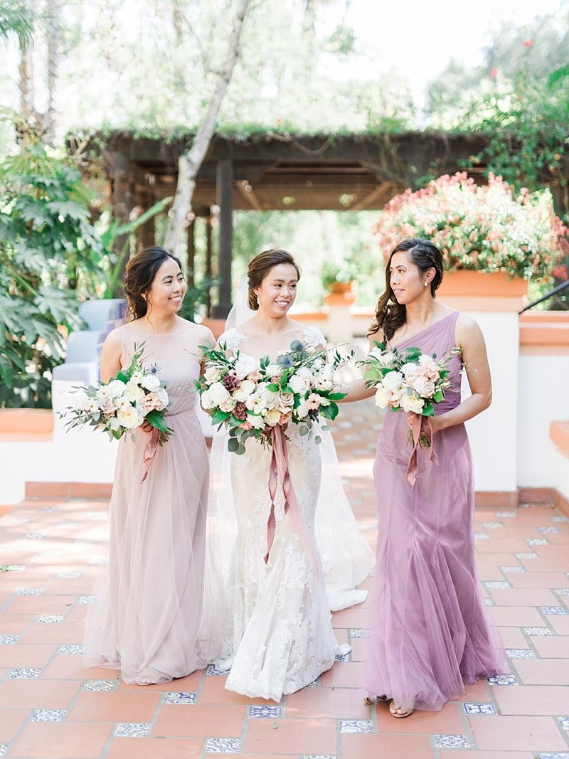 Mismatched purple bridesmaid dresses for romantic wedding style