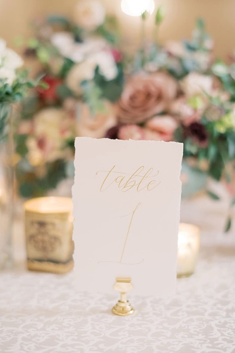 Simple and elegant fine art paper wedding table number with deckled edge