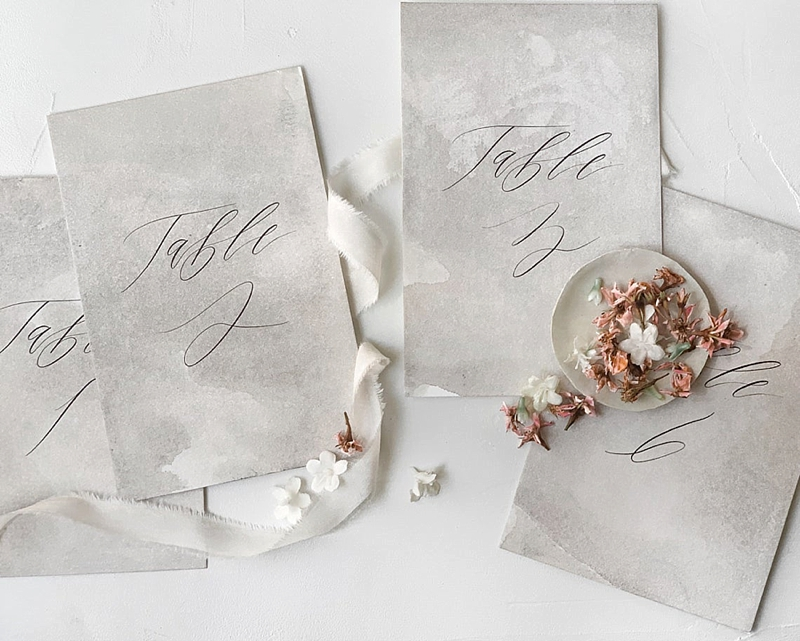 Elegant fine art wedding table numbers made with hand dyed paper and calligraphy