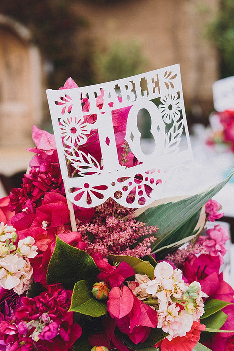 Fun and colorful Mexican papel picado wedding table numbers