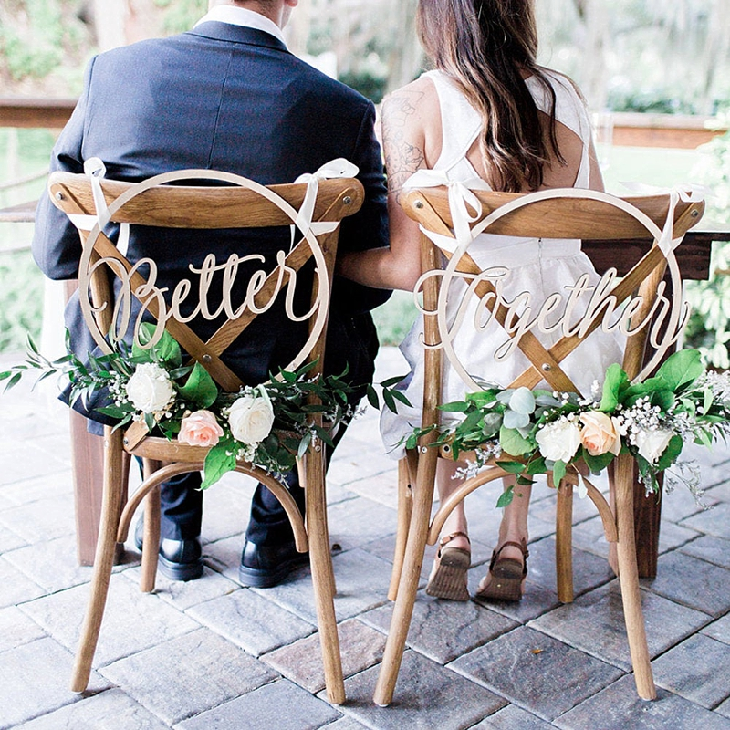 Round wooden Better Together wedding chair signs hung by white ribbon