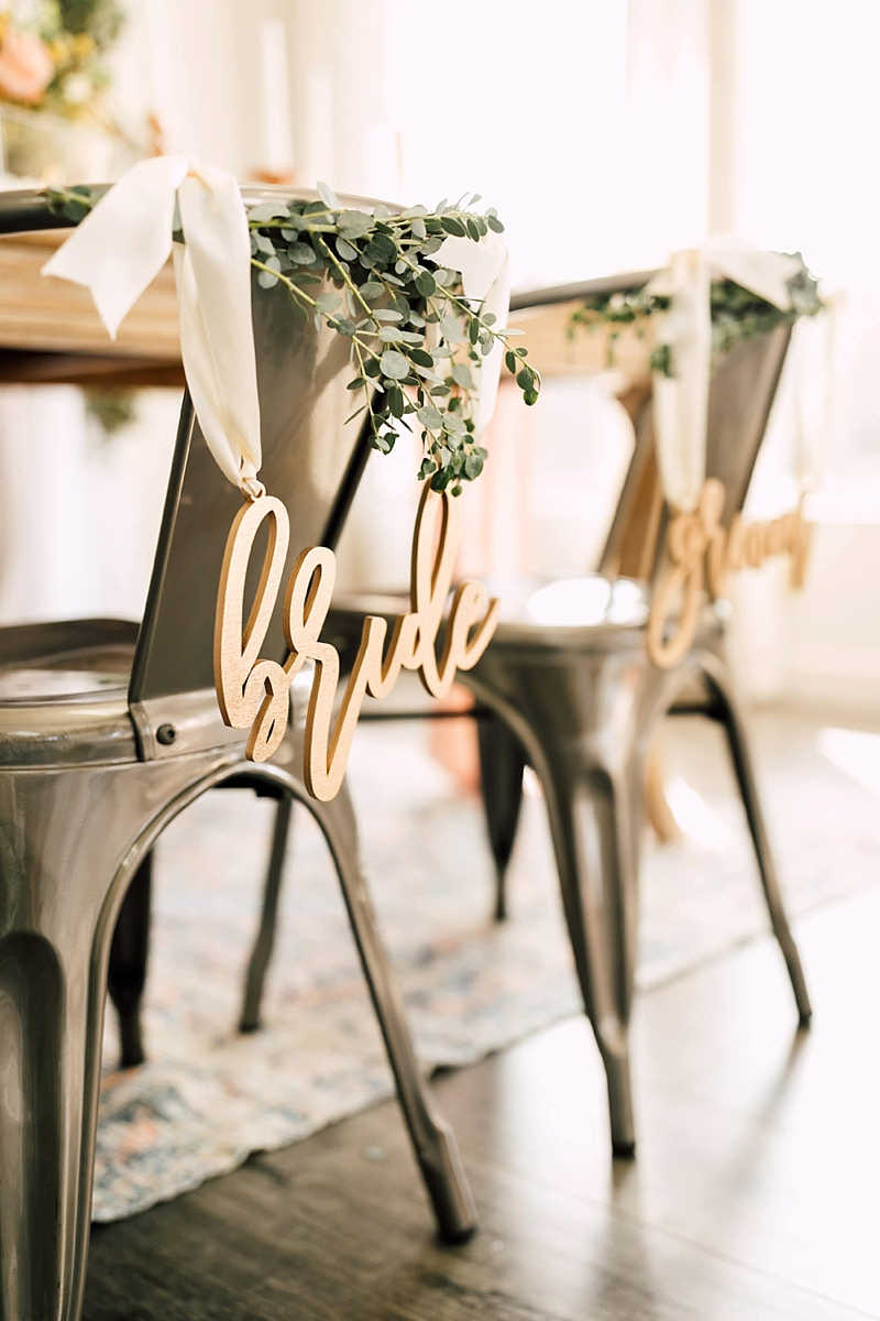 Wooden calligraphy Bride and Groom wedding chair signs tied up with ribbon