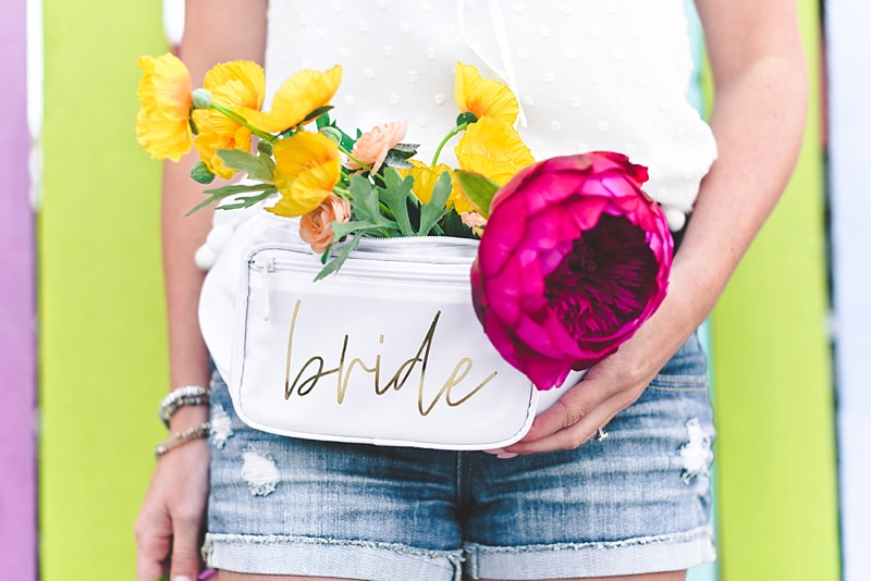 White DIY bridal fanny pack for summer bachelorette party made with Cricut and Martha Stewart