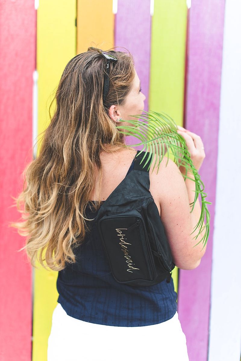 Black DIY bridesmaid fanny pack for summer bachelorette party made with Cricut and Martha Stewart