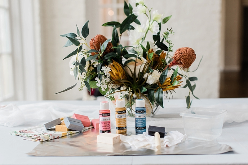 Materials for making easy colorful wood place card holders for a wedding or bridal shower