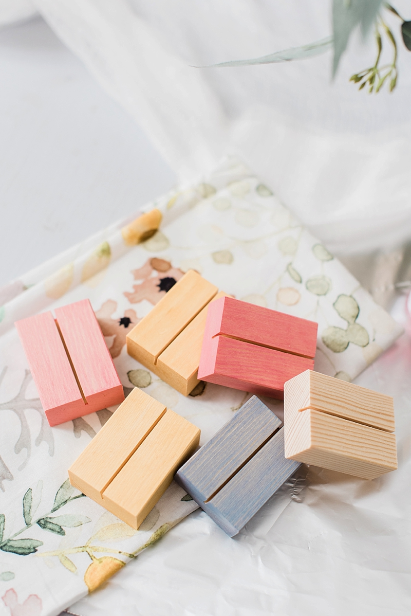 Beautiful DIY colorful modern wedding or bridal shower place card holders using a fun color wood stain