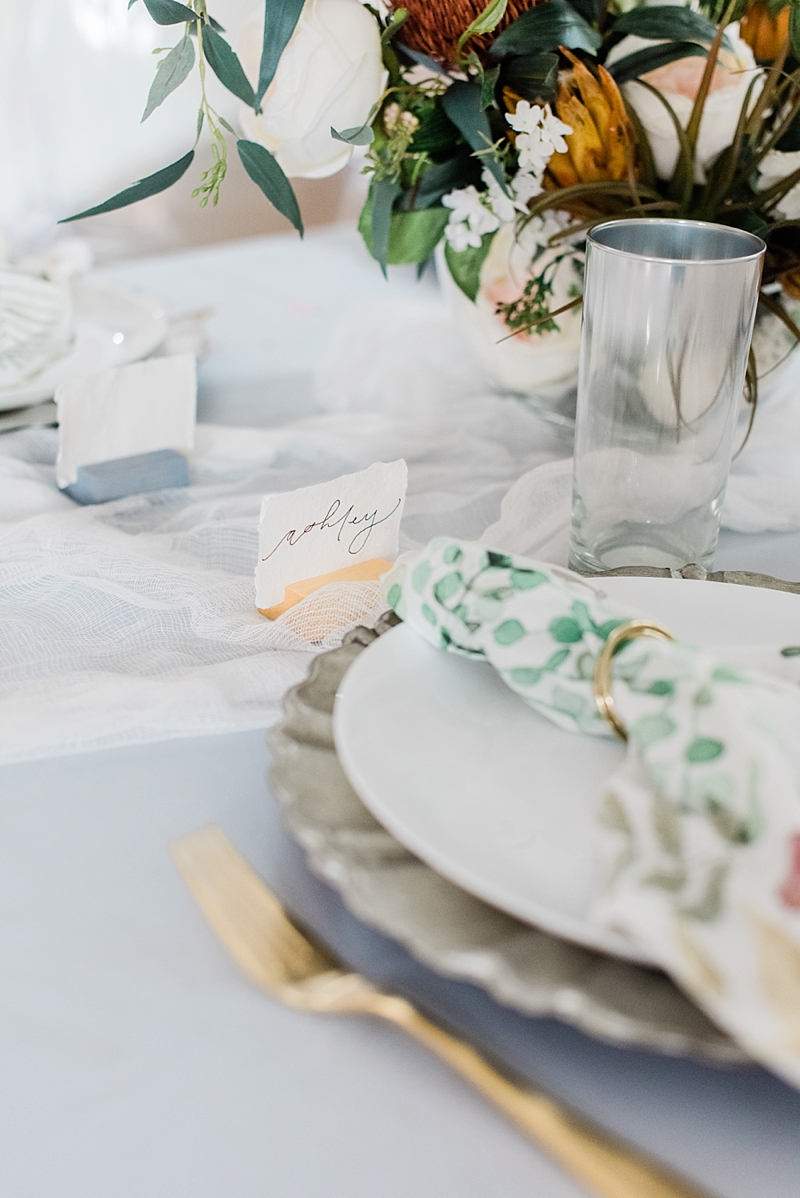 Modern romantic bridal shower table setting ideas with colorful place card holder and textured flowers