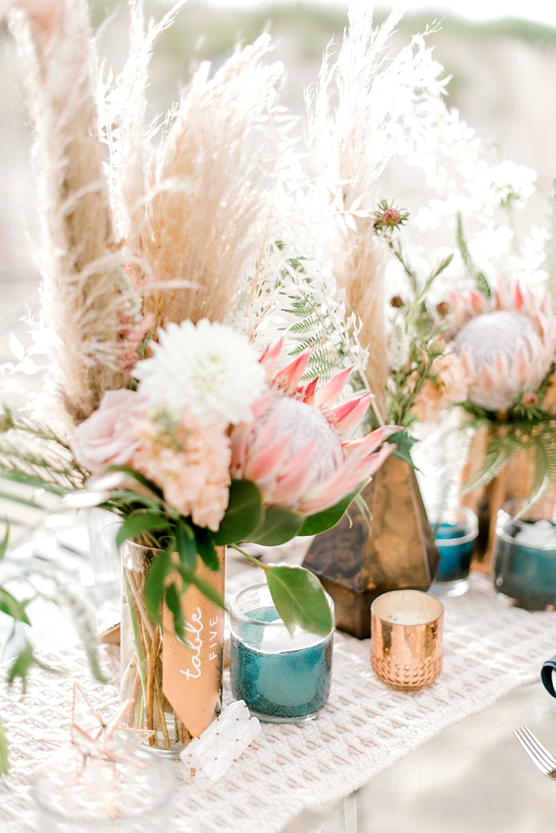 Textured copper boho wedding table numbers with selenite crystals and pampas grass
