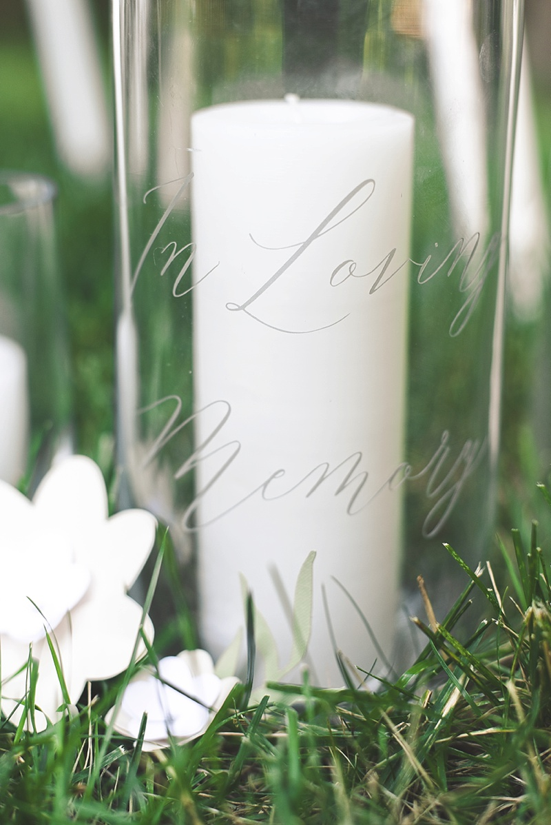 In Loving Memory message placed on hurricane vases for a sweet way to remember lost loved ones on the wedding day