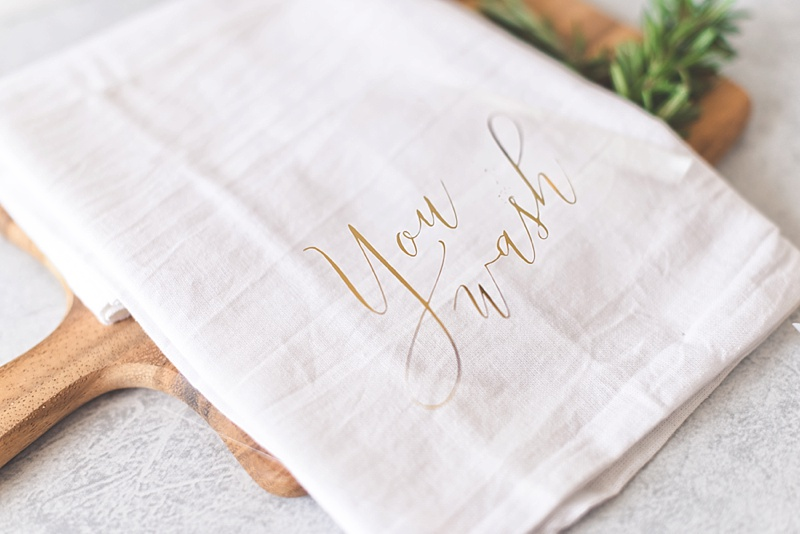 How to personalize DIY cotton kitchen towel gifts for the newlyweds with gold iron on foil and Cricut